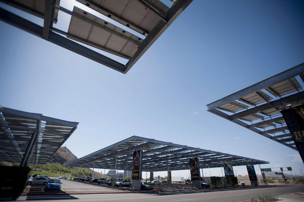 Solar panels stand above a parking lot at Arizona State University in Tempe.