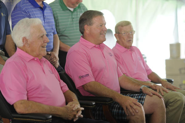 From left, Ara Parseghian, Brian Kelly and Lou Holtz pose for photos Wednesday with golf foursomes during the Irish Legends golf outing at Lost Dunes Country Club in Bridgman.