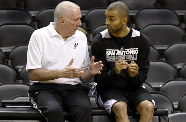 Spurs Coach Gregg Popovich talks with point guard Tony Parker during practice.