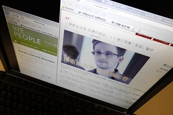 "A statement by Hong Kong online media platform supporting Edward Snowden is seen alongside a petition ""Pardon Edward Snowden"" at the White House website."