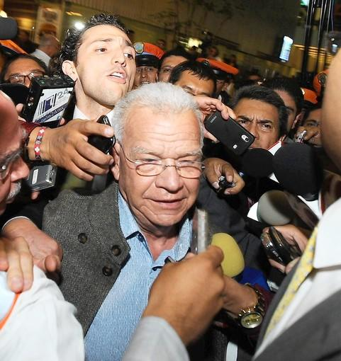 Andres Granier, former governor of Mexico's Tabasco state, arrives at the airport in Mexico City. He traveled from his home in Miami to meet with federal officials investigating the possible misuse of public funds during his term.