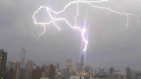 Lightning strikes the Willis Tower during the storm Wednesday night.