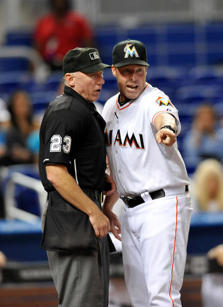 Jun 12, 2013; Miami, FL, USA; Miami Marlins manager Mike Redmond (right) argues with home plate umpire umpire Lance Barksdale (left) during the fourth inning against the Milwaukee Brewers at Marlins Park. Mandatory Credit: Steve Mitchell-USA TODAY Sports ORG XMIT: USATSI-122282
