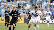 Orlando City's Long Tan, who scored the only goal of the match, works against Sporting Kansas City of Major League Soccer. (John Rieger, USA Today Sports)