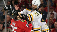 Game 1 photos: Hawks 4, Bruins 3 (3 OT)