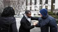 "Floyd, lead plaintiff in the class-action lawsuit Floyd v. City of New York, regarding the NYPD's ""stop and frisk"" crime-fighting tactic, greets a well-wisher after departing Manhattan Federal Court in New York"