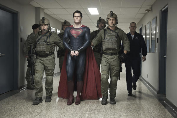 "Henry Cavill (center) as Superman and Christopher Meloni (far right) as Col. Nathan Hardy star in ""Man of Steel."""