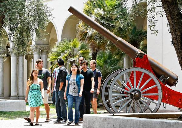 Students at Caltech walk past a cannon. In a tradition dating back to 1896, the cannon will be fired at the end of commencement ceremonies Friday.