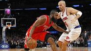 Houston Rockets Harden drives to basket defended by New York Knicks Kidd in NBA basketball game in New York