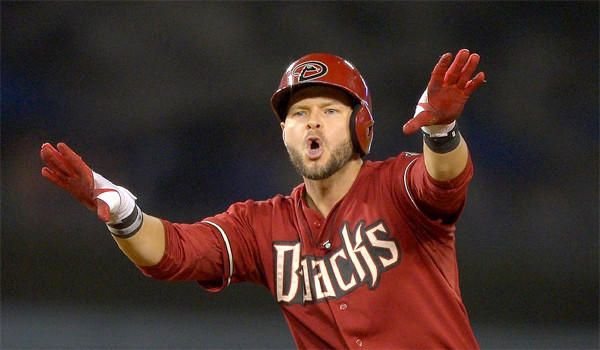 Cody Ross gestures to the Diamondbacks dugout after scoring the go-ahead run in the 12th inning of Arizona's 8-6 extra inning victory over the Dodgers on Wednesday.