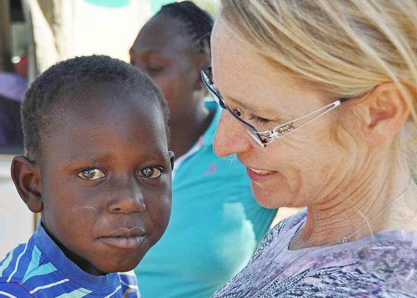 Shirley-Anne Beretta, director of South Africa Medical Expedition, holds one of the orphan children SAME looks after. He lives with his grandparents, an adult cousin, and her child. From birth he has had a lung condition that often requires him to be hospitalized. Berretta will speak at a fundraiser dinner to support SAME at Black forest Farms Harbor Springs at 5 p.m. on Friday, June 29.