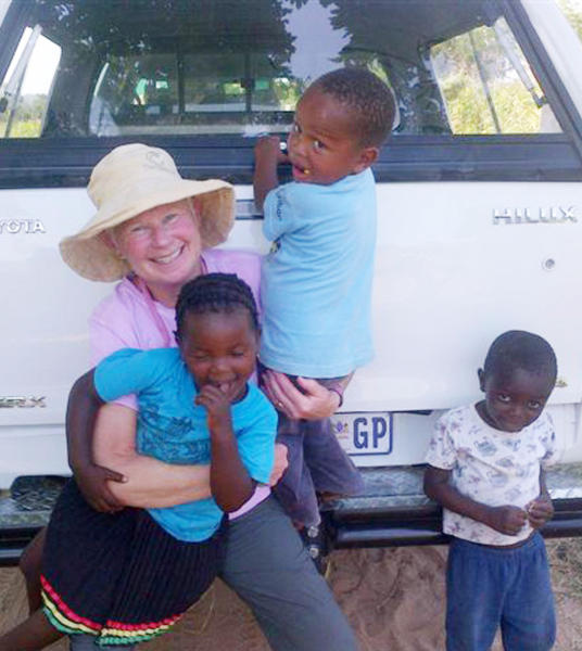 Sue Blayaert enjoys some time with children in Kayalani, South Africa as part of a medical expedition sponsored by South Africa Medical Expedition, a local nonprofit group.
