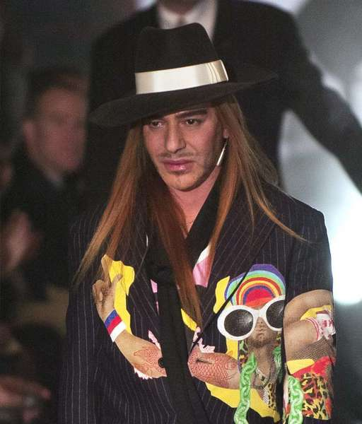 John Galliano in a customary end-of-show costume in Paris in 2005.