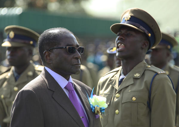 Zimbabwean President Robert Mugabe inspects an honor guard of police officers Thursday in Harare, the country's capital.
