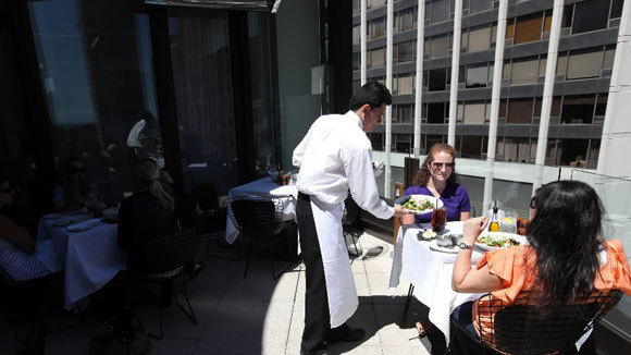Diners eat lunch on the terrace at Freds in the Barneys building on Oak Street in 2011.