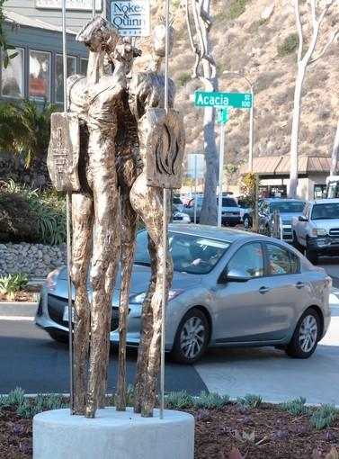 "Artist Cheryl Ekstrom's new sculpture ""Warrior's United"" was installed on Broadway Street -- not far from a dangerous curve -- as part of the city's Art in Public Places."