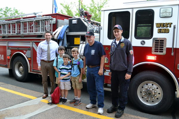 Auctions to benefit two elementary schools in Avon resulted in a ride to school for three brothers who attend Pine Grove School. Pictured from left to right are Pine Grove School Assistant Principal Jess Giannini; Gregory Russo; Christopher Russo; Joey Russo; AVFD Fire Police member Dennis Bianchi and AVFD firefighter Aaron Gelber, who drove the fire engine.