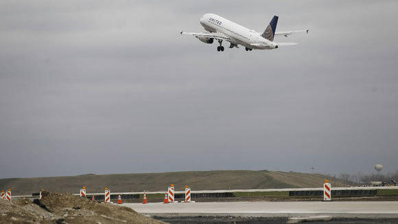 A United jet takes off from a runway next to one under construction at Chicago O'Hare International Airport in April.