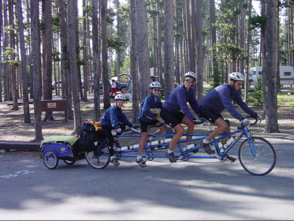 """Gilbert Newbury (right) leads his family on coast-to-coast bicycle trip on their bicycle built for four. The trip is the subject of Newbury's new book, """"Pedal to the Sea."""""""