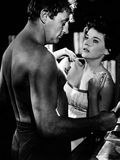 "Polly Bergen and Robert Mitchum in ""Cape Fear."""
