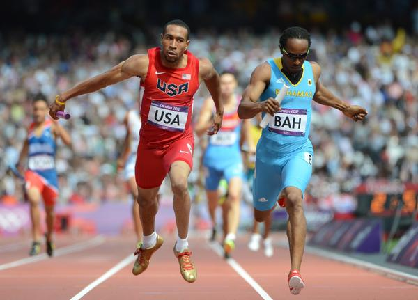 USC's Bryshon Nellum, shown competing in the 2012 Olympic Games at London next to the Bahamas' Chris Brown, won the NCAA 400-meter championship last weekend.