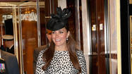The duchess of Cambridge, only weeks away from her due date, looked fetching in an animal print coat, saucy black hat and high heels Thursday as she christened a new cruise ship, called, fittingly, the Royal Princess.