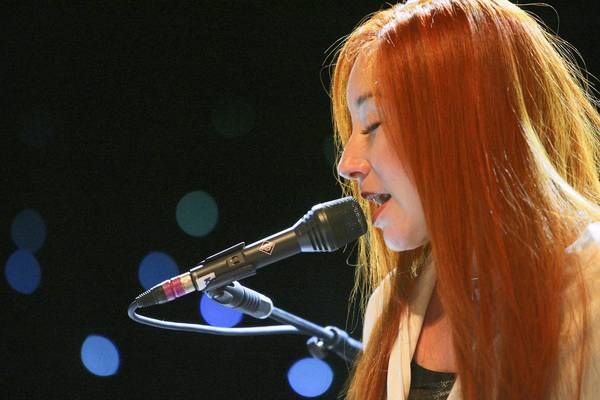 The music of Tori Amos, pictured at a 2009 Orlando concert, figures into a new book by a professor at Valencia College in Orlando.