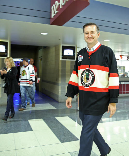 Chicago Cubs chairman Tom Ricketts exits after the Blackhawks' 4-3 triple-overtime win over the Bruins in Game 1 of the Stanley Cup Final at the United Center on Wednesday.