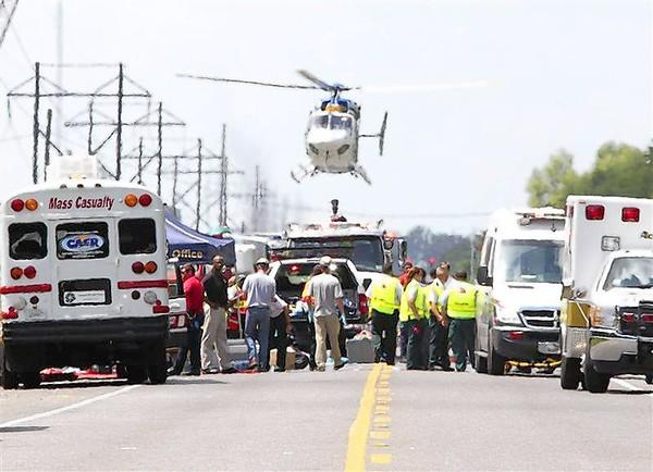 A Medevac helicopter lands at a triage center set up on highway LA 3115 near the Williams Olefins chemical plant, after an explosion and fire there, in Geismar, Louisiana.