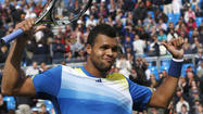 France's Jo-Wilfried Tsonga celebrates winning his men's singles tennis match against Igor Sijsling from Netherlands at the Queen's Club Championships in west London
