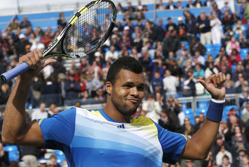 France's Jo-Wilfried Tsonga celebrates winning his men's singles tennis match against Igor Sijsling from Netherlands at the Queen's Club Championships in west London June 13, 2013. REUTERS/Eddie Keogh (BRITAIN - Tags: SPORT TENNIS)