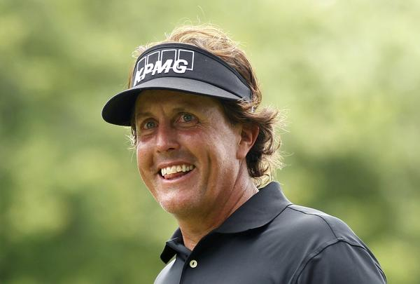 Phil Mickelson smiles as he stands on the second tee Thursday.