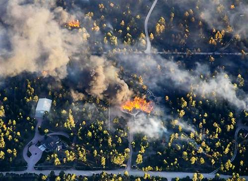 An aerial photo shows wildfire burning homes in Black Forest community near Colorado Springs, Colorado.