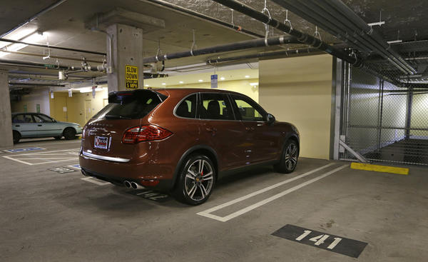 A Porsche SUV is parked in space No. 142 on Thursday in a parking lot near AT&T Park in San Francisco. A spot in the city's trendy South Beach neighborhood sold last week for $82,000. The 8- by 12-foot parking space is in an enclosed garage in a condominium building.