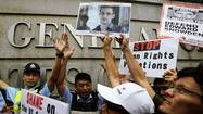 Protesters supporting Snowden confront police outside the U.S. Consulate in Hong Kong