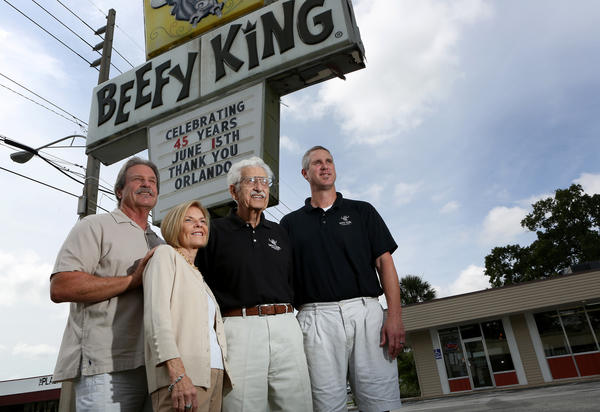 Roland and Sandee Smith, left, pose with Roland's father Freeman Smith and their son-in-law James Woodrow at Beefy King in Orlando on June 11, 2013. The iconic restaurant will celebrate its 45th anniversary on Saturday.