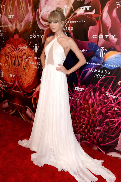 Taylor Swift shows off her Emilio Pucci gown at the 2013 Fragrance Foundation Awards in New York on Wednesday. Swift was honored as Fragrance Celebrity of the Year. She has three signature fragrances, including the recently released Taylor by Taylor Swift. In 2011, her Wonderstruck was the top-selling celebrity fragrance.
