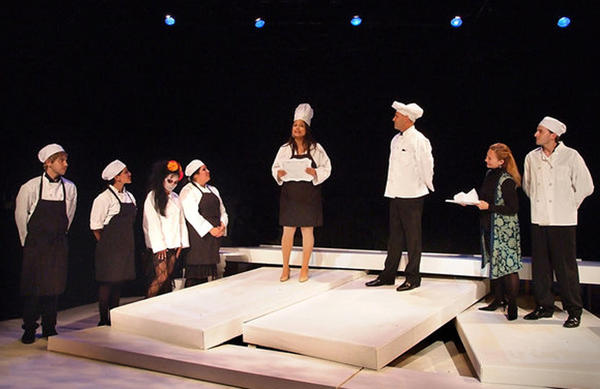"""Rachel Gonzalez, center, and her cooking school colleagues in """"Hungry Woman"""" at Casa 0101 Theater."""