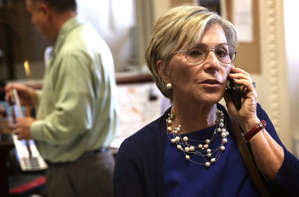 Sen. Barbara Boxer (D-Calif.) gets in a quick call prior to a news conference on Capitol Hill.