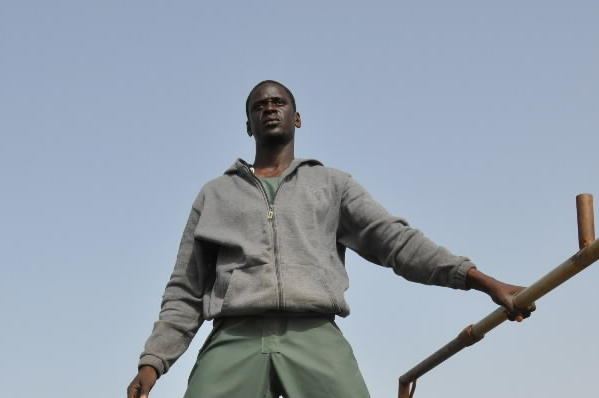 """Baye Laye (Souleymane Seye Ndiaye) is among a ragtag assortment of emigrants on a shaky boat, seeking economic opportunity in Europe in a scene from the film """"The Pirogue."""""""