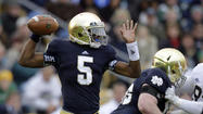 BRIDGMAN, Mich. (AP) — Coach Brian Kelly says Notre Dame quarterback Everett Golson and UCLA defensive lineman Eddie Vanderdoes won't be playing college football this fall for the same reason: accountability.
