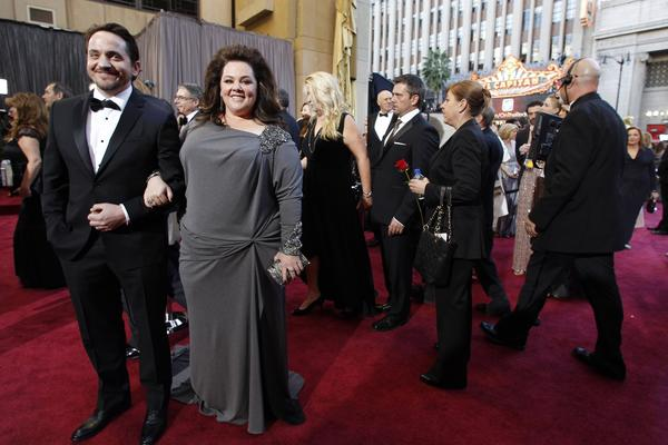 "Melissa McCarthy, photographed here with husband Ben Falcone, has responded to film critic Rex Reed's ""Identity Thief"" review in which he called the actress ""tractor-sized."""