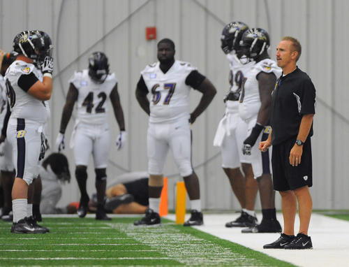 Ravens senior defensive assistant Steve Spagnuolo, right, is pictured during practice on third day of minicamp at the Under Armour Performance Center.