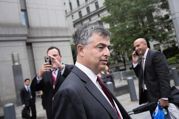 Eddy Cue, the Apple Inc. executive in charge of negotiating the company's controversial e-book deals, leaves federal court in Manhattan on Thursday.