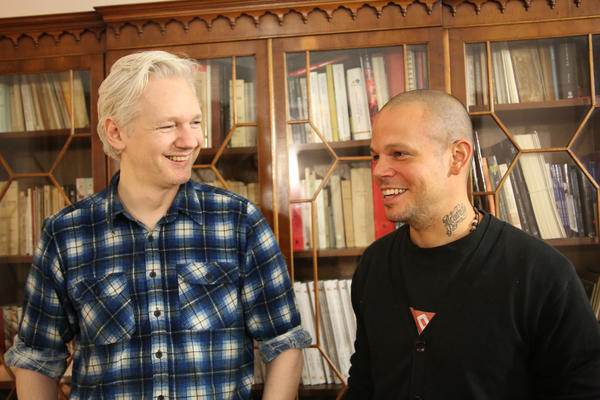 Julian Assange, left, and Rene Perez Joglar (a.k.a. Residente) of Calle 13.