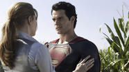"Amy Adams as Lois Lane, left, and Henry Cavill as Superman in ""Man of Steel."" (Clay Enos / Warner Bros.)"