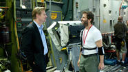 "Producer Christopher Nolan, left, and director Zack Snyder on the set of ""Man of Steel."" (Clay Enos / Warner Bros.)"