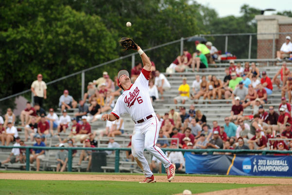 Indiana first baseman Sam Travis catches a pop fly against the Florida State Seminoles during the Tallahassee super regional of the 2013 NCAA baseball tournament