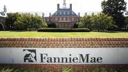 Fannie Mae has fired the executive who headed its Irvine office amid a federal investigation into alleged kickbacks from real estate brokers.