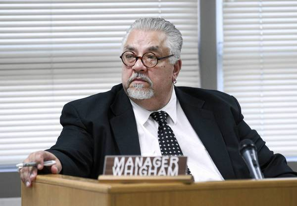 Hazel Crest Village Manager James Whigham Sr. denies any misconduct involving raises for him and two subordinates.